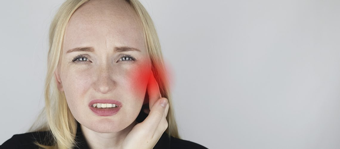 A Woman Suffers From Pain In The Ear. The Auditory Meatus Hurts